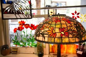 Northwest Garden Bling's storefront in Concrete offers a visual feast of glass creations, including an award-winning lamp. The works are made by owner-artist Athena Hornsby (below) and other artists. PHOTOS BY JESSAMYN TUTTLE