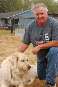Livestock Advisor John Nelson, also President of the Livestock Masters Foundation, with his dog Bear. PHOTO BY CAROL FREY